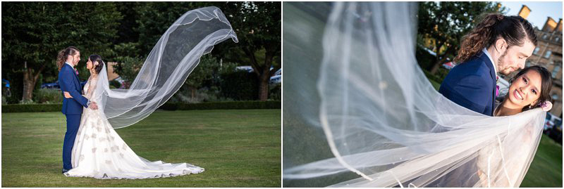 bride and groom in Principal hotel gardens with the cathedral veil blowing in the wind